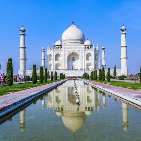 love dome: AGRA, INDIA - NOV 15, 2011: people visit the  mausoleum Taj Mahal in India, the worlds famous grave.