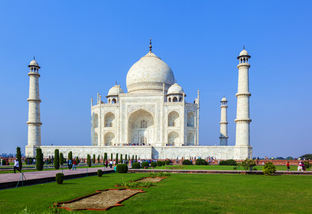 dome of hindu temple: AGRA, INDIA - NOV 15, 2011: people visit the  mausoleum Taj Mahal in India, the worlds famous grave.