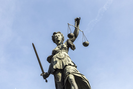 lady justice at the roemerberg under blue sky Stock Photo
