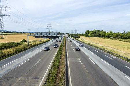 a3: FRANKFURT, GERMANY - JUNE 28, 2015: pattern of highway A3 in Germany with white line markers Editorial