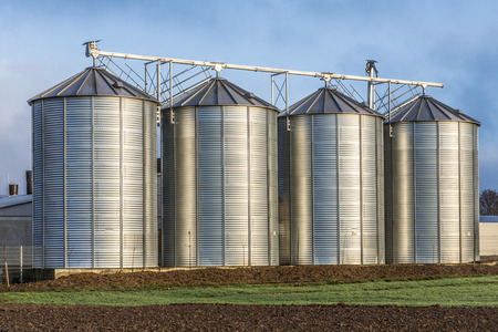 Silo in beautiful landscape with dramatical light placed in plouged acres Stock Photo
