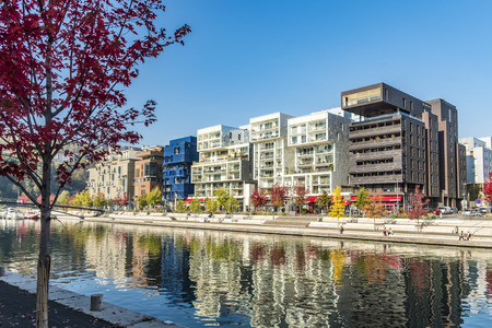 LYON, FRANCE - NOV 1, 2016: famous Confluence District with people in Lyon, France with river. The modern architecture is famous and won lot of prices. Redakční