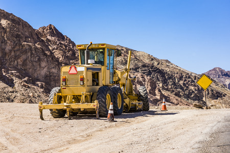 bulldozer on narrow road called Artists drive in Death valley