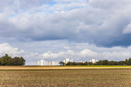 housing blocks in beautiful landscape in middle of the farming area with beautiful sky