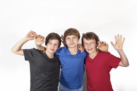 three happy joyful young friends enjoy life photo