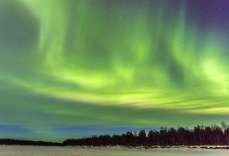 ionosphere: Northern Lights (Aurora borealis) over snowscape. Stock Photo