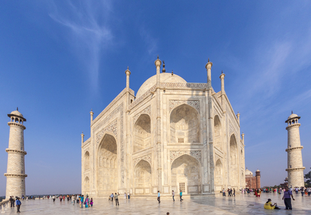 AGRA, INDIA - NOV 15, 2011: people visit the  mausoleum Taj Mahal in India, the worlds famous grave.
