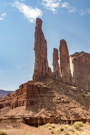 the three sisters in Monument Valley tribe park under blue sky