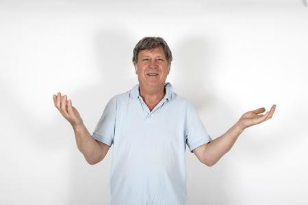 portrait of happy smiling mature man gesturing photo