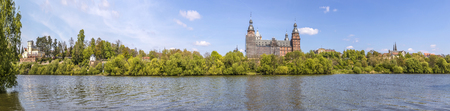 skyline of old aschaffenburg castle with river Main and Pompejanum under blue sky Standard-Bild