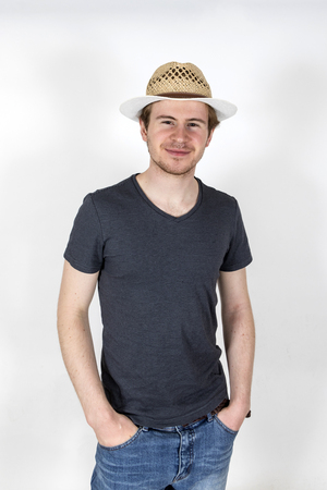 portrait of smiling young man with sunhat photo