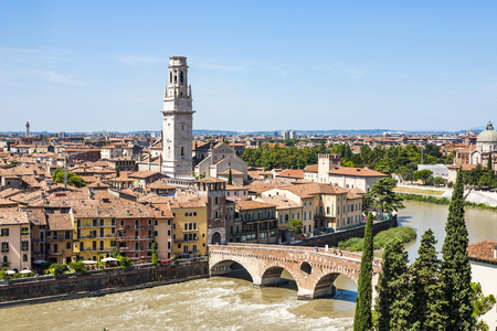 VERONA, ITALY - AUG 5, 2009: panorama of Verona with view of the old dome and the roman bridge, spanning river Etsch