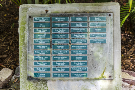 KEY WEST, USA - AUG 27, 2014: graveyard for the cats in Earnest Hemmingways garden. The cats are named like famous actors.