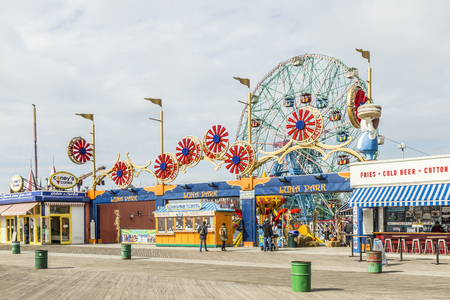 CONEY ISLAND, USA - OCT 25, 2015: people visit famous old promenade at Coney Island, the amusement beach zone of New York.