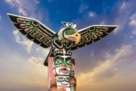 first nations: old traditional wooden totem masks in Canada