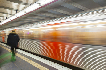 turnouts: train with speed in motion and blurred passenger Stock Photo