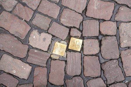 FREIBURG, GERMANY - JUNE 29, 2014: Stumbling blocks at Freiburg, Germany. Plates inscribed with the name and life dates of victims of Nazi extermination or persecution. Sajtókép