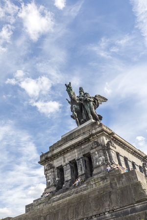Koblenz, Germany - MAY 21, 2017:  view over the plaza at the German corner Deutsches Eck, people visit the monument of Kaiser Wilhelm where the river Mosel joins the Rhine.