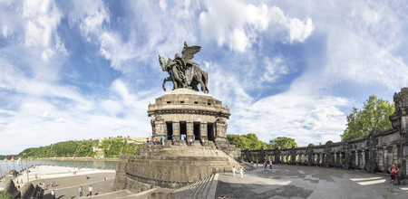 Koblenz, Germany - MAY 21, 2017: Panorama view over the plaza at the German corner Deutsches Eck, people visit the monument of Kaiser Wilhelm where the river Mosel joins the Rhine. Editorial