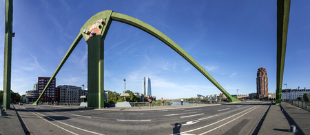FRANKFURT, GERMANY - MAY 16, 2017: panorama of new headquarters of the European Central Bank with river main, floesser bridge and main plaza skyscraper in Frankfurt.