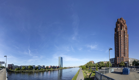 FRANKFURT, GERMANY - MAY 16, 2017: panorama of new headquarters of the European Central Bank with river main and main plaza skyscraper in Frankfurt.
