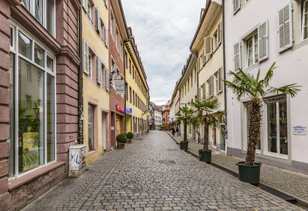 FREIBURG, GERMANY - JUNE 29, 2014: view to old town of Freiburg. The old facades are very well restored and their paintings are a tourist attraction.