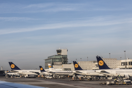 FRANKFURT, GERMANY - MAY 18, 2017: Terminal 1 with Lufthansa aircrafts in Frankfurt, Germany. With 38 million passengers per year it is one of the most important airport in Europe.