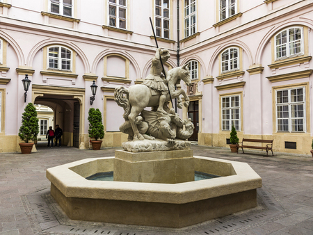 BRATISLAVA, SLOVAKIA, MAY 25, 2017: Statue of knight St George slaying the dragon - fountain in Primates palace, Bratislava. Bratislava is the capital of Slovakia on Danube River.