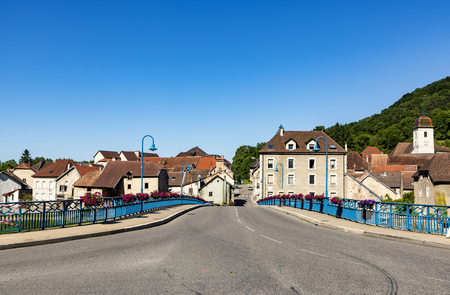 bridge at typical small village L-Isle-sur-le-Doubs in France in the Doubs valley. The history of the village dates back to the 13th century. Stock Photo