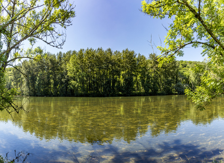 reflection at river Doubs in France on a sunny day Stock Photo