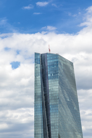 central european: FRANKFURT, GERMANY - JULY 29, 2017: view to ECB building with reflections of blue sky and clouds in facade . ECB was inaugurated in 2015 with demonstrations.  Actual head of ECB is Mario Draghi. Editorial
