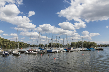 WALLUF, GERMANY - AUG 6, 2017: pier with private sailing boats at Walluf at river rhine. Walluf  harbor is specialized for private sailing boats. Editorial