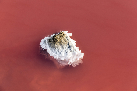 detail of  red Salt lake at Salin de Aigues-Mortes in the Camarque, France Banco de Imagens - 84229549