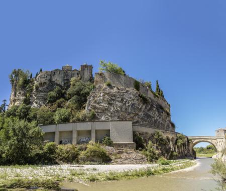 view to old town and historic roman bridge  in vaison la romaine