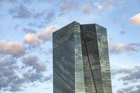 FRANKFURT, GERMANY - JULY 29, 2017: view to ECB building with reflections of blue sky and clouds in facade . ECB was inaugurated in 2015 with demonstrations.  Actual head of ECB is Mario Draghi. Editorial