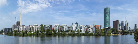 FRANKFURT, GERMANY - AUG 24, 2017: new West harbor buildings at the river Main in Frankfurt. The west harbor area was build in 2006 and ist an expensive in area in Frankfurt.