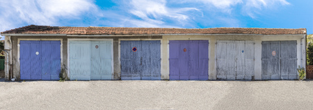 pattern of garage doors in a french village Stock Photo