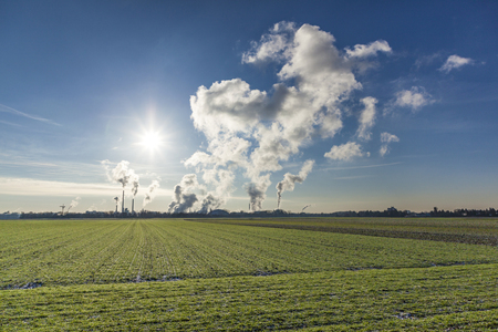 chimneys with smoke of an industrial area near Frankfurt Stock Photo