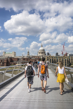 LONDON UK - JUNE 17, 2017: people on the way direction St Pauls Cathedral. It is an Anglican cathedral, the seat of the Bishop of London and the mother church of the Diocese of London, England, United Kingdom. Editorial
