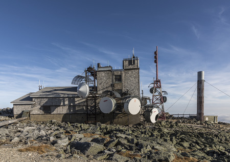 MT WASHINGTON, NH, USA - SEP 19, 2017: Mount Washington weather station operates since more than 100 years every day at the summit of Mount Washington. They measure relevant data for the weather forecast.