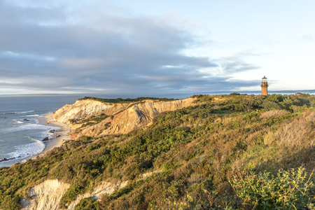 Gay Head Lighthouse and Gay Head cliffs of clay at the westernmost point of Marthas Vineyard in Aquinnah, Massachusetts, USA. This historic lighthouse was built in 1856.