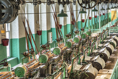LOWELL, USA - SEP 26, 2017: visit of the industry museum Boott cotton mills in Lowell, USA. The machine room is identical to the working conditions in the late 19th century.