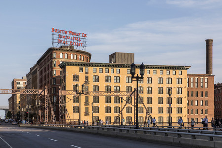BOSTON, USA - SEP 12, 2017; The Boston Wharf Company sign at  263 Congress Street, at the corner of Sleeper Street with skyline of historic industrial wharf Boston.