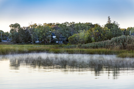 indian summer landscape with morning fog in small harbor village of Essex, Massachusetts