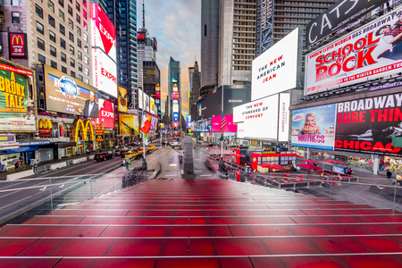 NEW YORK, USA - OCT 5, 2017:  neon advertising of News, brands and theaters at times square in late afternoon. Times square is a symbol for New York life and amusement. Editorial