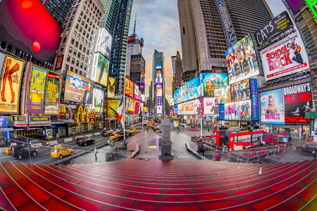 NEW YORK, USA - OCT 5, 2017:  neon advertising of News, brands and theaters at times square in late afternoon. Times square is a symbol for New York life and amusement. 報道画像