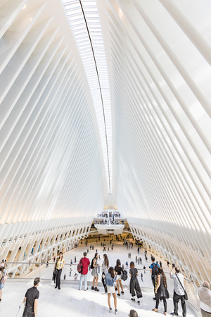 NEW YORK, USA - OCT 6, 2017: NEW YORK - SEPTEMBER 8: Oculus interior of the white World Trade Center station with people in New York. The station was designed by Santiago Calatrava, architect and engineer.