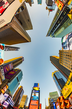 NEW YORK, USA  OCT 4, 2017:  neon advertising of News, brands and theaters at times square in late afternoon. Times square is a symbol for New York life and amusement. Editorial