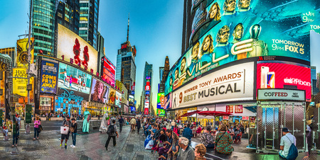 NEW YORK, USA  OCT 4, 2017:  neon advertising of News, brands and theaters at times square in late afternoon. Times square is a symbol for New York life and amusement. 報道画像
