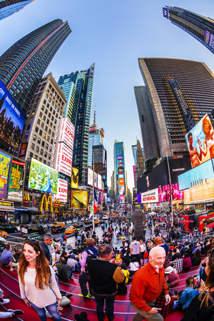 NEW YORK, USA OCT 4, 2017: neon advertising of News, brands and theaters at times square in late afternoon. Times square is a symbol for New York life and amusement.